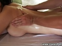 A busty beauty getting a massage